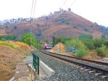 Treno locale che lascia Alora Fotografia Stock