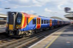 Treno nazionale della ferrovia nel moto Fotografia Stock