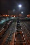 Trens de troca na noite Imagem de Stock Royalty Free