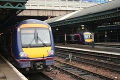 Trens na estação de comboio Fotos de Stock Royalty Free