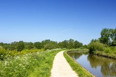 Trent and Mersey canal with towpath in Cheshire England United K Stock Photos