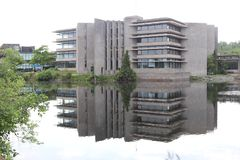 University campus reflected in the lake front stock images