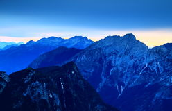 Trenta Valley during blue hour, Julian Alps, Slovenia. Trenta Valley during blue hour: forested Velika Ticarica and rocky Bavski Grintavec peaks with Visoki Stock Image