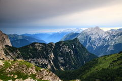 Trenta Valley with mist at dusk, Julian Alps. The hazy Trenta Valley with Bavski Grintavec and Kanin peaks behind, after storm at dusk, from Triglav Lakes Valley Royalty Free Stock Photography