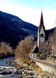 Italy, Trentino Alto Adige, Bolzano, San Candido, view of the Aurino River with the small church dedicated to the Holy Spirit. Trentino Alto Adige, Bolzano, San royalty free stock image