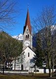 Italy, Trentino Alto Adige, Bolzano, San Candido, view of the Aurino River with the small church dedicated to the Holy Spirit. Trentino Alto Adige, Bolzano, San royalty free stock photo