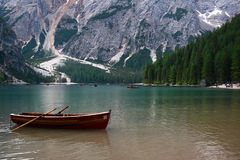 Trentino Alto Adige, Italy - Braies Lake. View of a lonely boat in the Braies Lake in the summer stock image