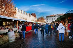 TRENTO, ALTO ADIGE, ITALY - DECEMBER 17, 2016: traditional Christmas market. TRENTO, ALTO ADIGE, ITALY - DECEMBER 17, 2016: People in the traditional Christmas royalty free stock image