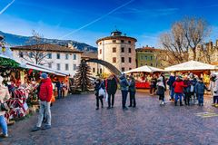TRENTO, ALTO ADIGE, ITALY - DECEMBER 17, 2016: traditional Christmas market. TRENTO, ALTO ADIGE, ITALY - DECEMBER 17, 2016: People in the traditional Christmas stock photography