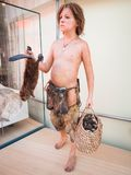 Realistic statue of a prehistoric boy in the Museum of Science i Royalty Free Stock Photos