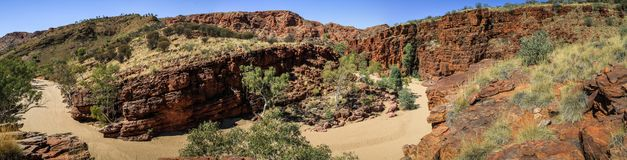 Panoramic view on The sheer quartzite cliffs at Trephina Gorge, East MacDonnell Ranges, Northern Territory, Australia. Trephina Gorge, in the East MacDonnell stock images