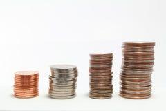 Treppe trat Stapel US-Münzen Stockbilder