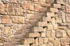 Treppen in der Steinwand Stockbild