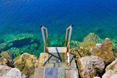 Treppen zum Meer Stockbild