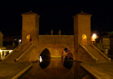 Trepponti bridge by night in Comacchio. Italy Stock Photography