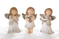 Tres ángeles de la Navidad en el blanco aislado para la decoración Imagen de archivo