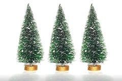 Tres árboles de navidad artificiales Fotografía de archivo