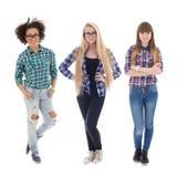 Tres adolescentes atractivos aislados en blanco Imágenes de archivo libres de regalías