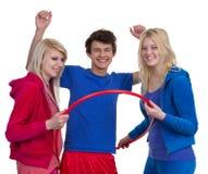 Tres adolescentes con un aro de los deportes Imagen de archivo