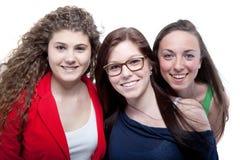 Tres adolescentes lindos aislados sobre blanco Imagen de archivo libre de regalías