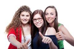 Tres adolescentes lindos aislados sobre blanco Fotografía de archivo