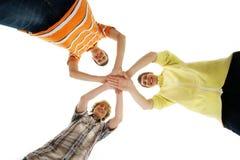 Tres adolescentes que se sostienen en una forma de una estrella Fotografía de archivo