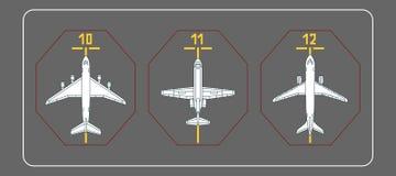 Tres aeroplanos en el delantal terminal Imagenes de archivo