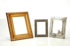 Tres aislaron marcos vacíos adornados en blanco Fotografía de archivo libre de regalías
