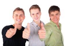 Tres amigos dan gesto Imágenes de archivo libres de regalías
