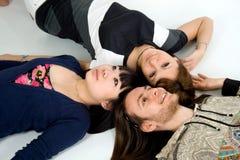 Tres amigos felices Fotografía de archivo libre de regalías