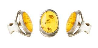 Tres anillos con el ámbar, un collage Imagen de archivo libre de regalías