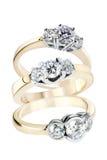 Tres anillos de oro con los diamantes Foto de archivo libre de regalías