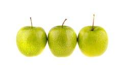Tres Apple verde, aislado en el fondo blanco Fruta Fotos de archivo