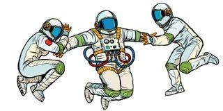 Tres astronautas en espacio en aislante de la gravedad cero en el fondo blanco ilustración del vector