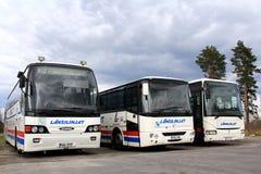 Tres autobuses parqueados Fotos de archivo libres de regalías