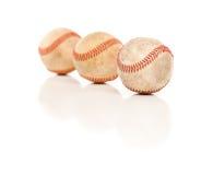 Tres béisboles aislados en blanco reflexivo Imágenes de archivo libres de regalías