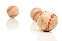 Tres béisboles aislados en blanco reflexivo fotos de archivo libres de regalías