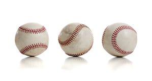 Tres béisboles en el fondo blanco Foto de archivo