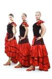 Tres bailarines en trajes españoles nacionales Imágenes de archivo libres de regalías