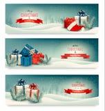 Tres banderas de la Navidad con los presentes Imágenes de archivo libres de regalías