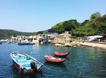 Tres barcos en el golpecito Mun Pier Imágenes de archivo libres de regalías