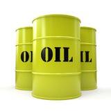 Tres barriles de aceite amarillos aislados en el fondo blanco Fotografía de archivo
