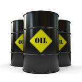 Tres barriles de aceite negros aislados en el fondo blanco Imagen de archivo