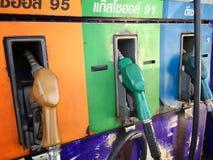 Tres bocas de la bomba de gas en la gasolinera Foto de archivo libre de regalías