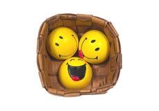 Tres bolas amarillas divertidas en pannier trenzado Foto de archivo libre de regalías