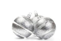 Tres bolas claras de la Navidad con las rayas del brillo Foto de archivo libre de regalías