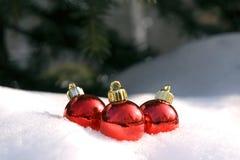 Tres bolas de la Navidad Imágenes de archivo libres de regalías