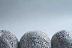 Tres bolas de las lanas i una fila Imagen de archivo libre de regalías