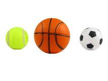 Tres bolas de los deportes sobre blanco Foto de archivo