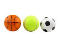 Tres bolas de los deportes sobre blanco Fotos de archivo libres de regalías